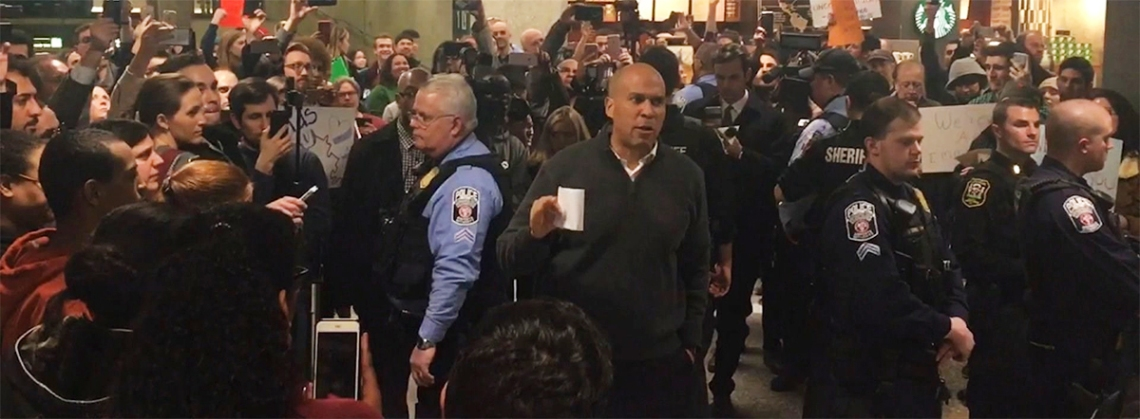 Senator Cory Booker (D-NJ), at Dulles International Airport, speaking to protestors against President Trump's travel ban.